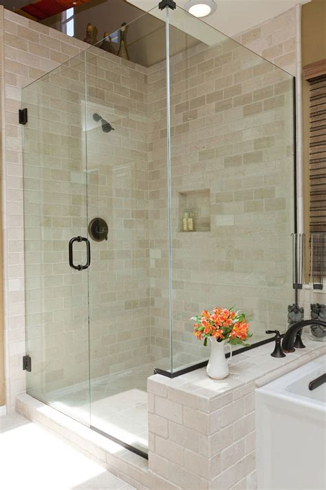 tumbled marble tile bathroom traditional with glass shower