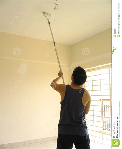 paint man man painting ceiling stock image image of labourious