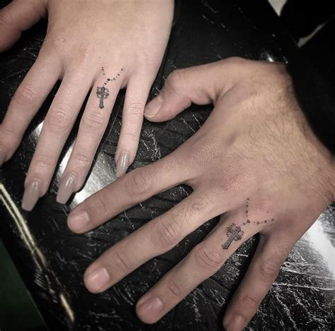 his and her knuckle tattoos by isaiah negrete tattoos