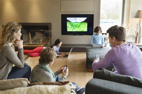 asian family watching tv together in living room this is 1 decline in quality family time 10 ways tv has changed