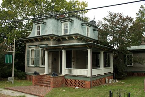 exterior cool front porch with exterior stairs and porch railings also exterior paint color