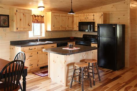 unstained wooden kitchen cabinet using black countertop and black wooden barstool using