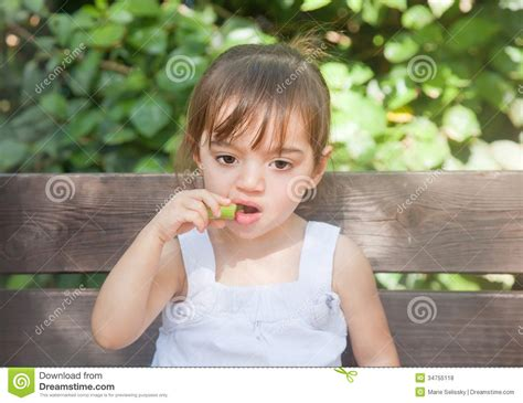 girl with cucumber thoughtful girl eating cucumber royalty free stock photos
