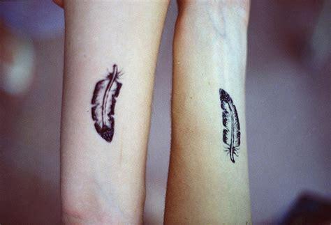 matching best friend tattoos on the wrist matching best friends feather tattoos on wrists