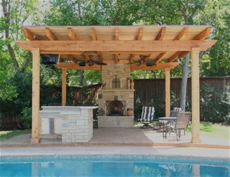 covered outdoor seating covered seating area with a stone fireplace and outdoor