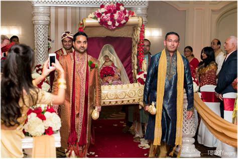 Indian Groom Makes Dramatic Entrance by Gorgeous Golden Gown And Ravi Irvine