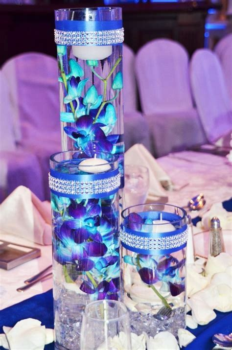 Floating blue submerged orchids with floating candles
