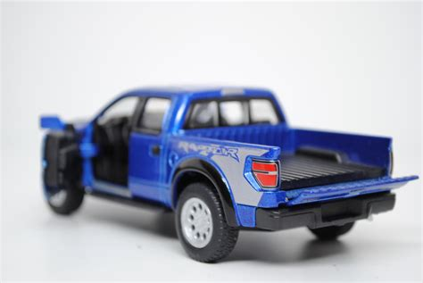 Ford F 150 Raptor Kinsmart kt5365 blue ford f 150 svt raptor supercrew 2013 kinsmart