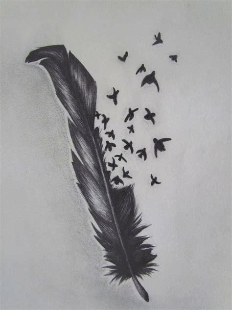 feather with birds tattoo meaning center bird feather designs tattoomagz