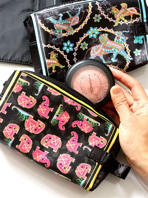 Mac Makeup Bag In Blue by Is That A Griffin Gracing The Mac Bollydoll Collection