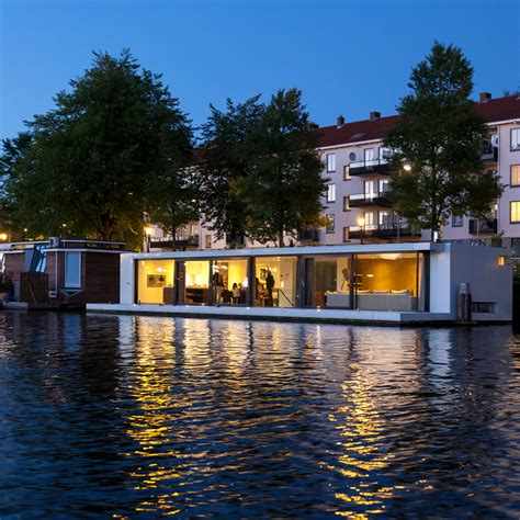 floating boat hotel amsterdam floating home moored on an amsterdam river