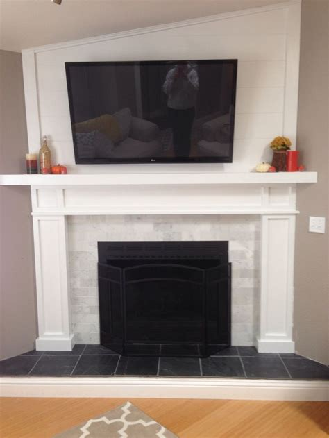 Black And White Fireplace Tiles by Fireplace With Black Slate Hearth And Marble Subway Tiles Wood Paneling Mounted Tv