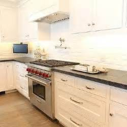 kitchen tv ideas white and black kitchen with white exposed brick backsplash