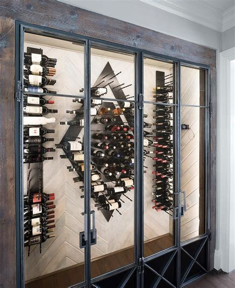 contemporary wine room features a wood herringbone wall