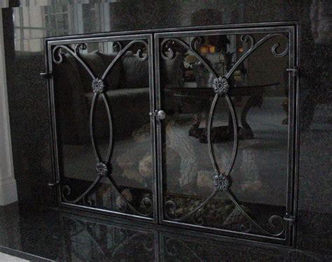 fireplace screen with glass doors on custom fireplace