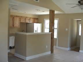 This living room dining and kitchen has been remodeled and painted