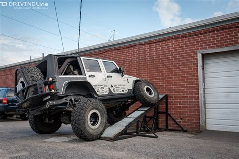 lowered jeep wrangler unlimited flexing for fun with low range 4x4 drivingline