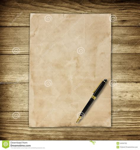 old brown paper and pen on wooden wall background for
