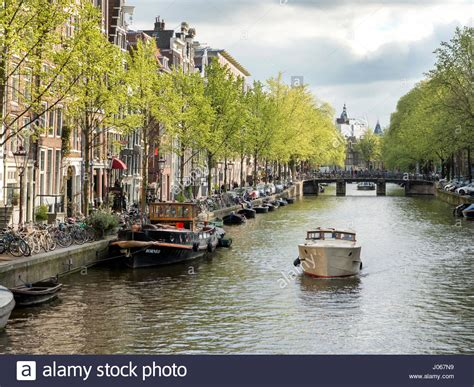 sailing boat on canal small boat amsterdam canal stock photos small boat