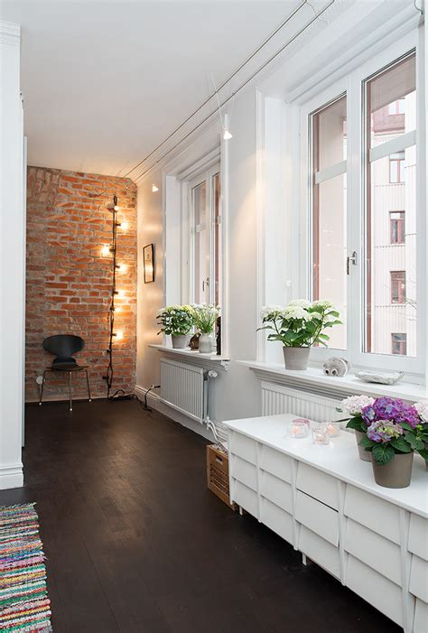 home and decor flooring p apartment with terrrace white bedroom with hardwood flooring and exposed brick wall