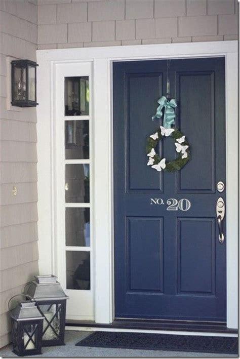 front door number navy front door painted number seasonal wreath lanterns