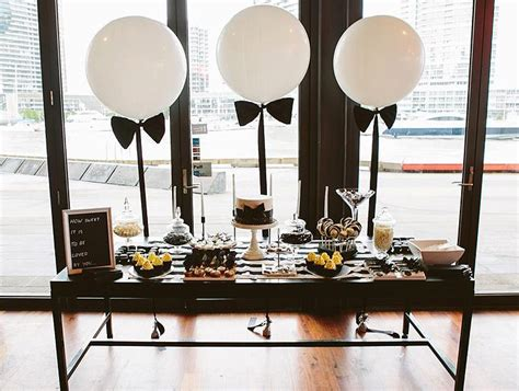 dessert tables on a budget inspiration bow ties black and white balloon bow ties event shots