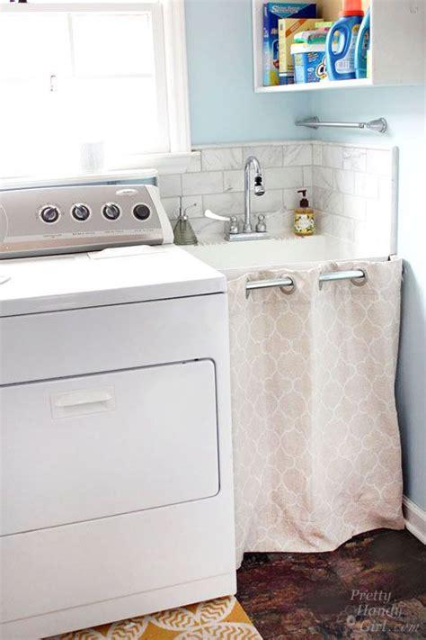under sink laundry her hidden storage under a laundry room sink pretty handy