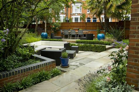 large paved garden terrace with sunken paved area and timber decking