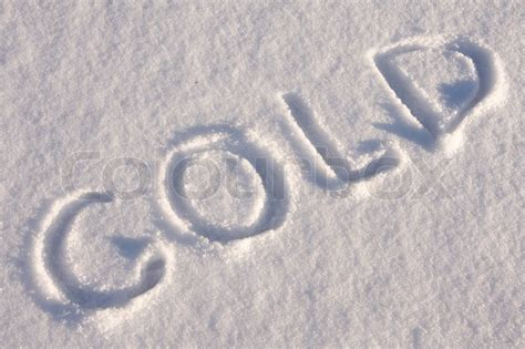"Writing text ""COLD""in sunny day on the snow   Stock Photo"