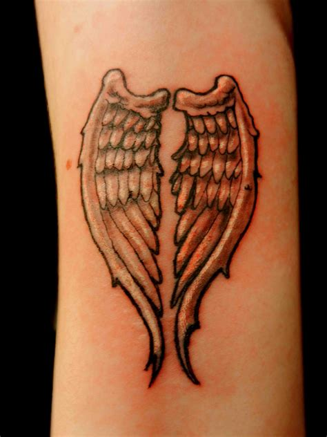 wrist wing tattoos wings wrist designs