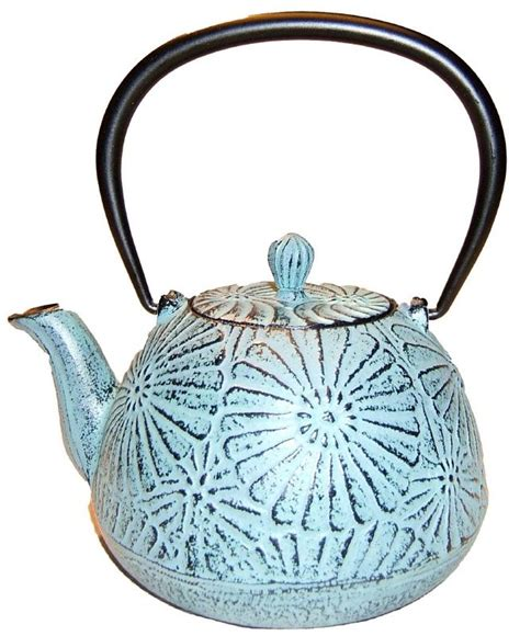 flower pattern kettles tetsubin cast iron tea pot in pale pale blue announcing a
