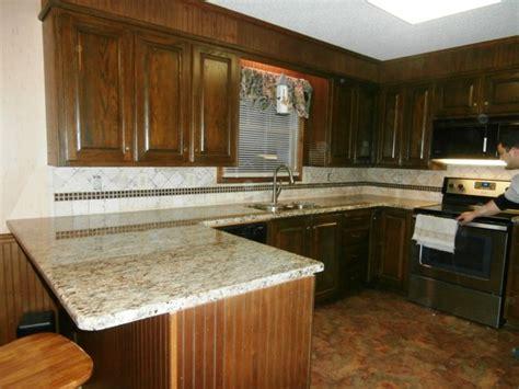 ST. CECILIA Granite on Dark Cabinets   Traditional