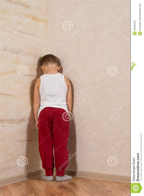 white facing white boy facing wooden walls stock photo image