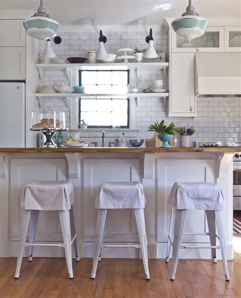 corbels for kitchen island white cottage kitchen with large kitchen island with