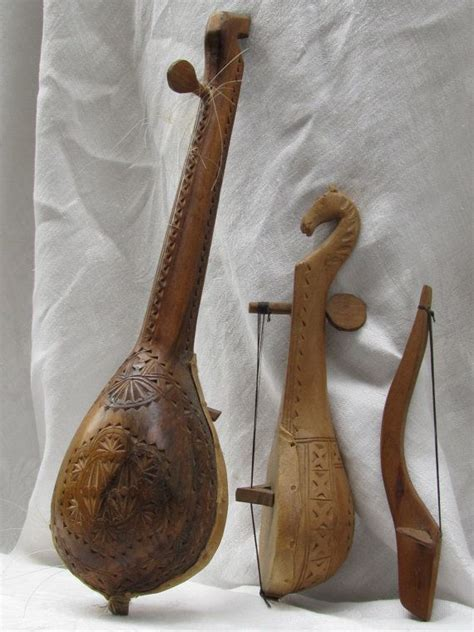 Unique String - unique gusle string instrument intricately carved