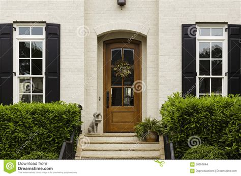 Front Door Statues Arched Front Door With Statue And Shrubs Stock Photo