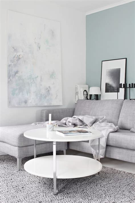 grey sofa wall color teal accent wall in a light gray living room blue paint