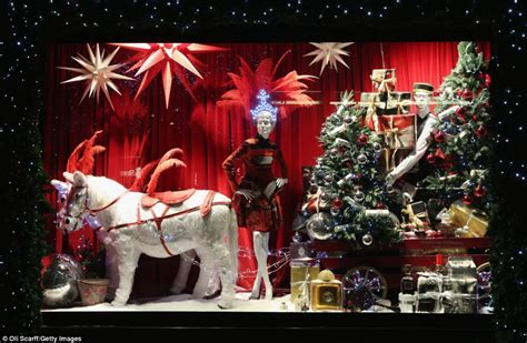 christmas house window displays a flying carpet and a giant gingerbread house london quot s department stores show off