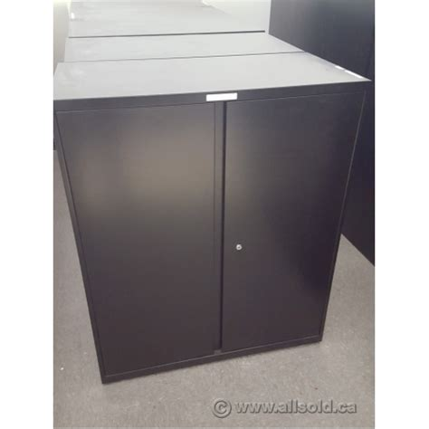 Metal 2 Door Storage Cabinet Teknion Black 36x18x42 2 Door Metal Storage Cabinet Locking Allsold Ca Buy Sell Used
