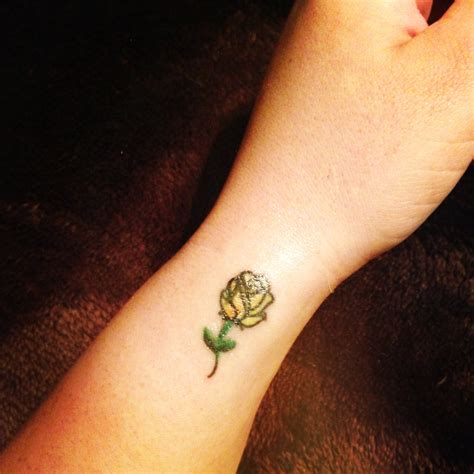 tiny rose tattoo small yellow loyalty