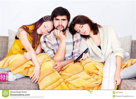 two girls having on the couch on the couch stock photo image 46170046