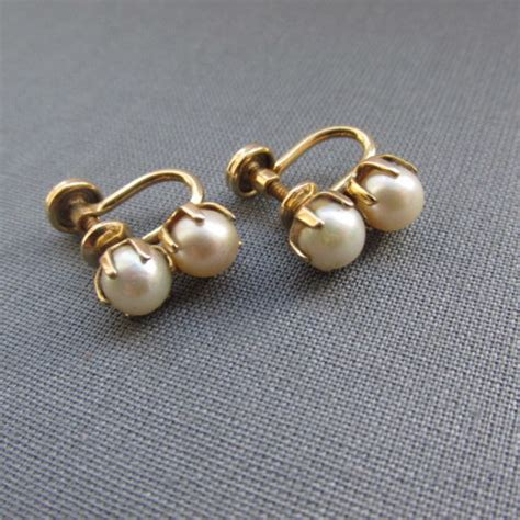 pearls with gold pearl and gold finish earrings