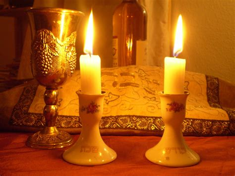 shabbos candle lighting times my father s daughter lighting the shabbat