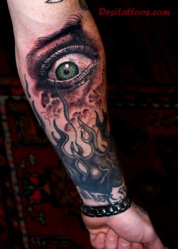 eye tattoo forearm colorful scary joker face tattoo on forearm by ufuk