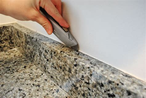 How To Remove Granite Countertop by Removing The Side Splash Backsplash From Our Bathroom