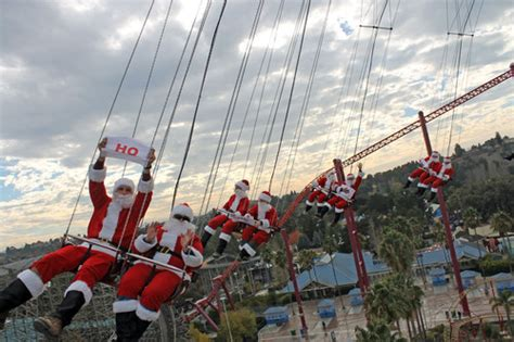 six flags swing ride flying santas swap sleighs for swings at six flags