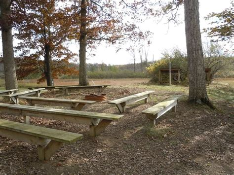 benches around fire pit our facility c talahi retreat and nature center