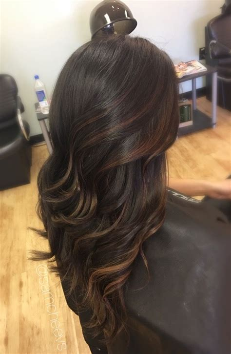 trendy to elegant black hair with caramel highlights trendy hair highlights caramel highlights for dark hair