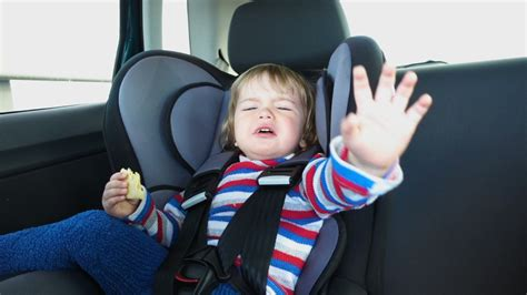 small child cries and screams in the car baby boy