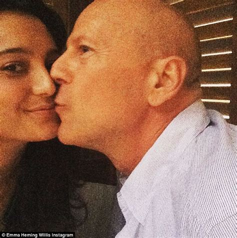 bruce willis and wife emma heming share a smooch after